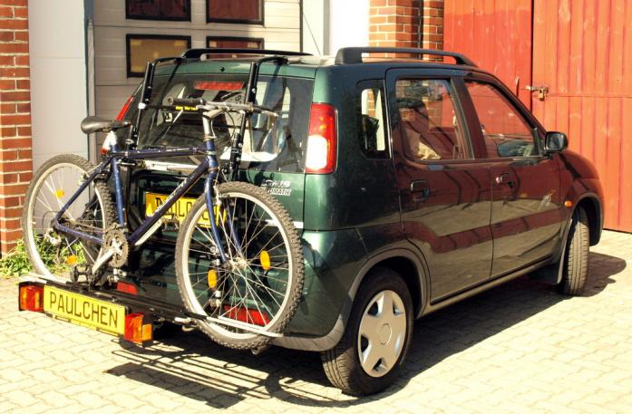 Suzuki Ignis (FH) Bike carrier with comfort load extension and loaded bike. Without trailer hitch!