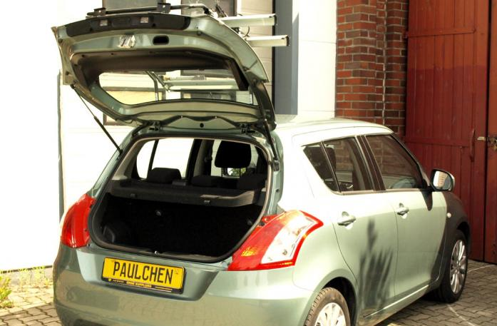 Suzuki Swift IV Bike carrier with open tailgate and mounted carrier