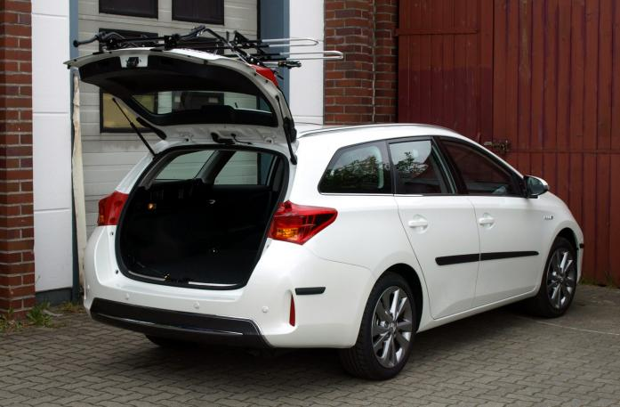 Toyota Auris Touring Sports Bike carrier with open tailgate and mounted carrier