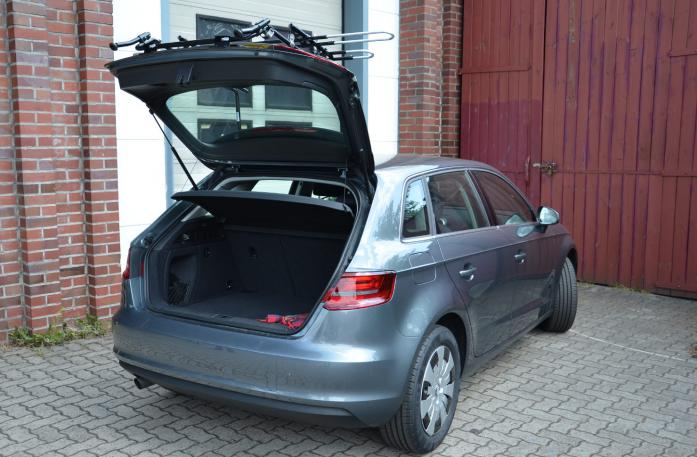 Audi A3 Sportback Bike carrier with open tailgate and mounted carrier