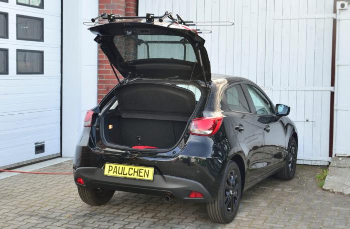 Mazda 2 (DJ) Bike carrier with open tailgate and mounted carrier