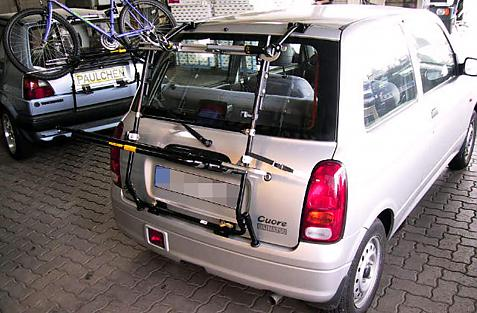 Daihatsu Cuore (L7) Bike carrier in loading position