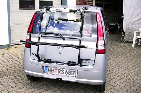 Daihatsu Cuore (L251) Bike carrier in loading position