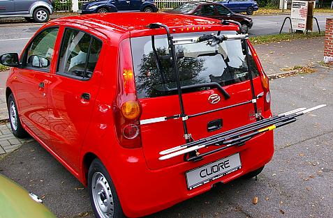 Daihatsu Cuore (L276) Bike carrier with comfort load extension in loading position. Without trailer hitch!