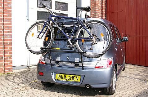 Daihatsu Materia Bike carrier loaded with bike